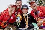 Stinna Tange Kaastrup celebrating her gold medal with volunteers.