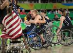 Christina Schwab USA (centre left) and Rose Hollermann USA (centre right) celebrate their team's victory 62 - 45 over Germany in the Wheelchair Basketball Women's Gold Medal Match