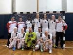 Team photo of men in white jerseys