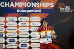 Maria Delgado Nadal of Spain on the podium after the women's 100m backstroke S12 at the 2015 IPC Swimming World Championships in Glasgow.