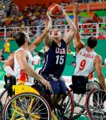 Athlete practicing wheelchair basketball.