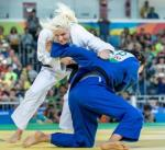 Two judo athletes fighting on the ground.