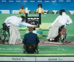 Athletes practicing wheelchair fencing.