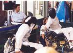 Two people in wheelchairs, fencing