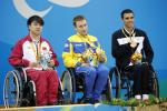 Three medallists in wheelchairs on the podium