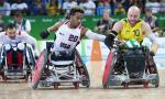 Australia's Chris Bond pushes down the court as USA's Josh Brewer reaches for the ball
