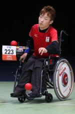 Man in wheelchair throwing a red boccia ball