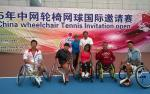 Group picture on a tennis court with some people in wheelchairs