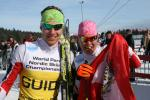 Two cross-country skiers with an Austrian flag