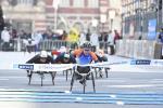 Japan's Sho Watanabe crosses the line to take the 2017 Tokyo marathon ahead of Switzerland's Marcel Hug.