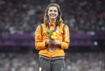 A picture of a woman celebrating her victory durign the medal ceremony