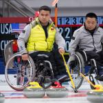 Chinese wheelchair curling players watching the stones