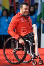 Wheelchair Racer and Paralympian Kurt Fearnley of Australia with the baton during the launch of The Queen's Baton Relay for the XXI Commonwealth Games being held on the Gold Coast in 2018 at Buckingham Palace.