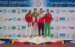 Four men stand on the podium
