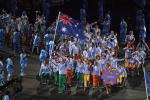 A group of Para athletes march into a stadium with one athlete holding the Australian flag during the Rio 2016 Opening Ceremony