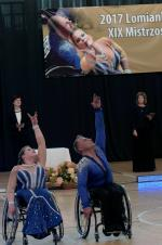 Man and woman in wheelchairs dance