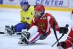 Ice sledge hockey players battle it out