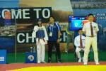 a para taekwondo fighter talks with his coach
