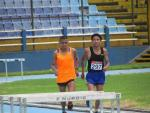 a Para athlete and his guide race on a track
