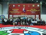 Group of people from a judo event pose for a photo