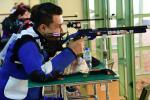Man competing in R9 (mixed 50m rifle prone SH2) event