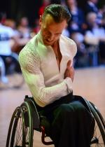 Male wheelchair dancer bows