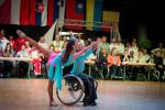 Man in wheelchair and woman standing dancer dance