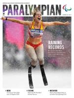 Cover of magazine with female sprinter celebrating in rain