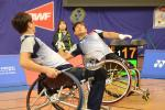 two male Para badminton players on the court