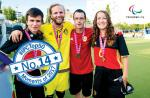 a group of blind footballers smile with their medals