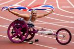 Samantha Kinghorn of Great Britain celebrates after winning gold in the Womens 100m T53 final at the London 2017 World Para Athletics Championships.