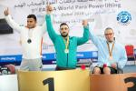 three male powerlifters on the podium
