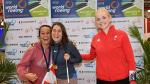 a group of female rowers celebrate