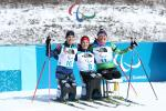 three female Nordic skiers hugging