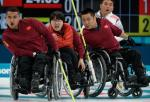 wheelchair curlers watching a stone