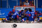 Para ice hockey players celebrating