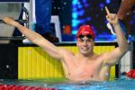 a male Para swimmer celebrates his win in the pool