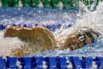 a male Para swimmer mid-freestyle stroke