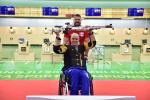 a male Para shooter and his coach celebrate
