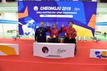 Three athletes in wheelchairs on a podium