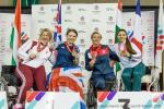 a group of female wheelchair fencers in a row