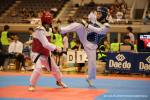 two male taekwondo fighters face off