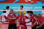 a men's sitting volleyball celebrate and shout on the court