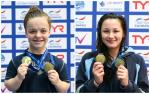 two female Para swimmers on the podium with medals around their neck