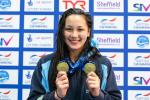 Great Britain's Alice Tai shows her two gold medals at the Sheffield 2018 World Series