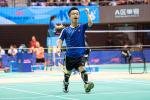 a male Para badminton player of short stature on the court