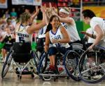 Women wheelchair basketball players celebrate