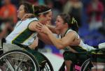 Two Australian wheelchair basketball players celebrate