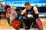 male wheelchair rugby player Daisuke Ikezaki tackles another player
