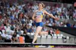 female Para sprinter Leilia Adzhametova crosses the finish line in an athletics stadium